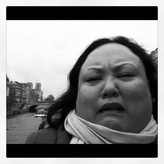 """Ms. Davila in Paris, pretending to be Adele singing """"Someone Like You"""" to the horror of nearby tourists."""